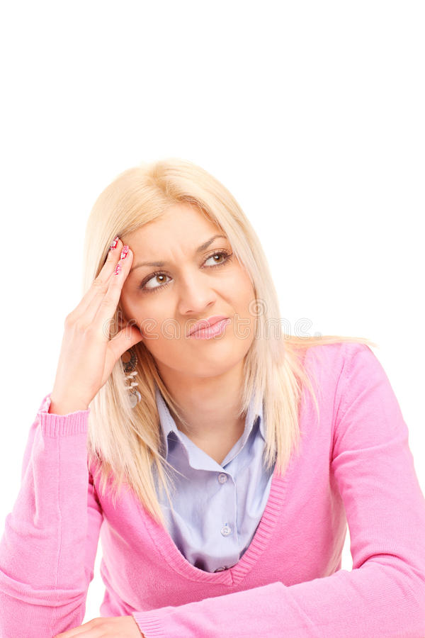 Displeased blond woman making a face stock photography