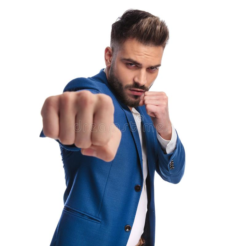Displeased man in suit threatening with fists stock photo