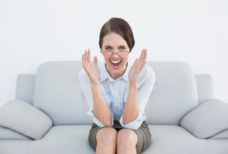 Download Displeased Well Dressed Woman Screaming On Sofa Stock Photo - Image: 35023268
