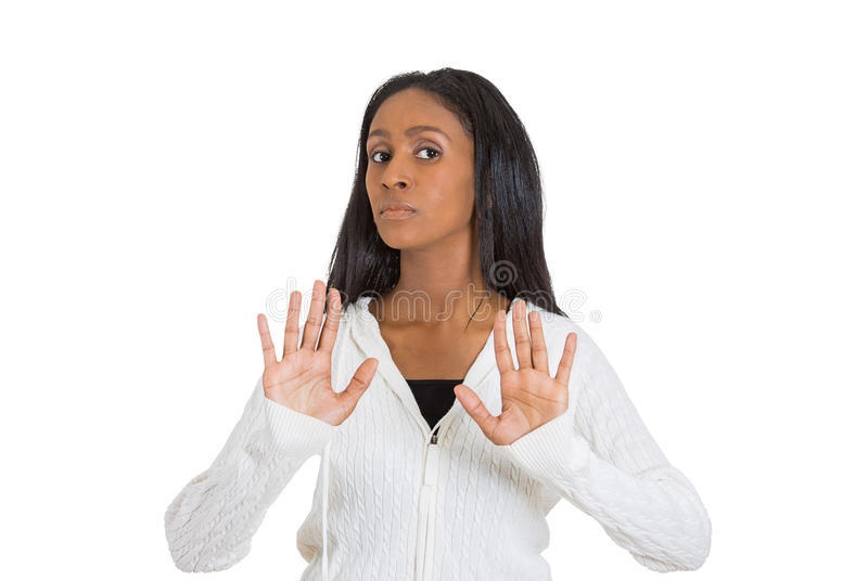 Displeased woman raising hands up to say no stop right there stock photography