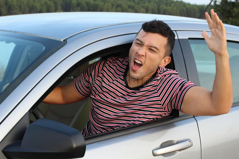 Displeased young driver rudely complaining stock images