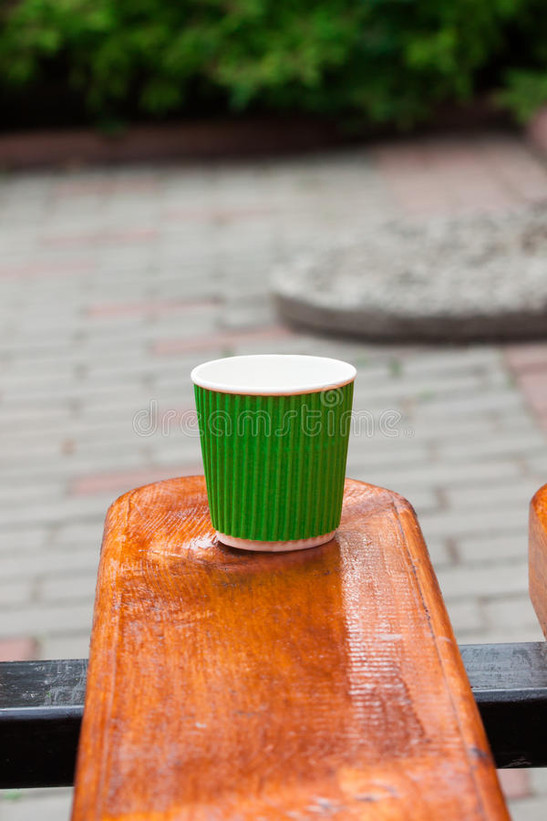 Disposable cup on the bench stock photography