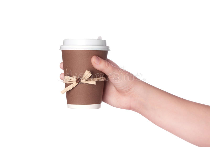 Disposable cup of coffee in hand royalty free stock image