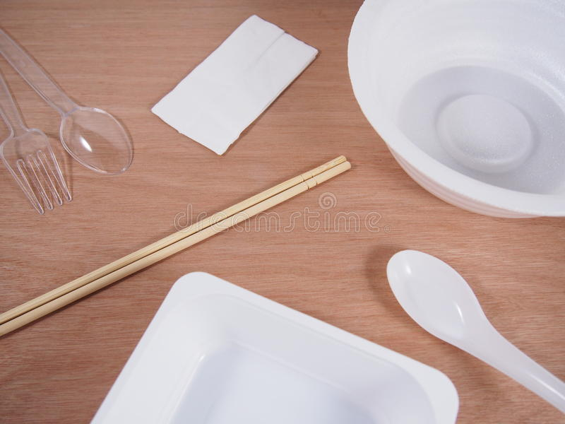 Disposable equipment,empty kitchen ware. On wood background stock photo
