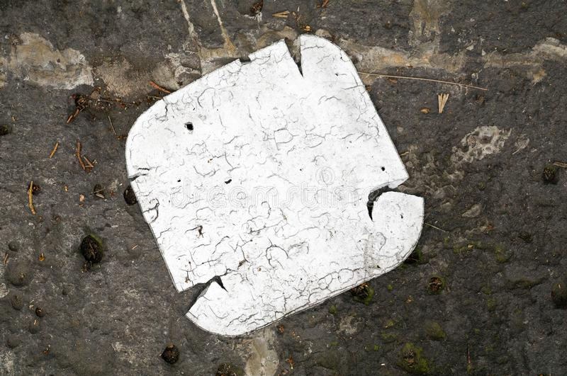 Pollution. A disposable expanded polystyrene tray is lying on the sidewalk. Their deterioration demonstrates the indifference and irresponsibility of people stock photography