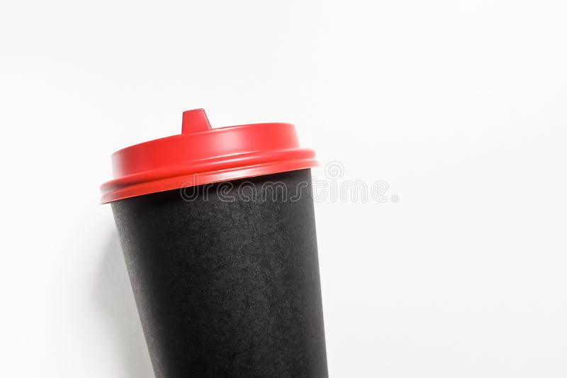 Disposable, paper Cup for coffee takeaway, with red plastic lid, isolated on white background, close-up royalty free stock images