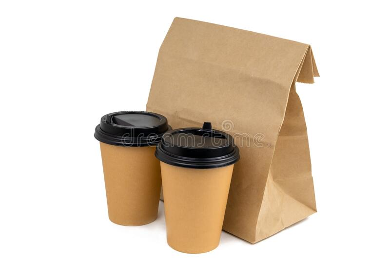 Disposable paper cups and a paper bag with food isolated on a white background stock photos