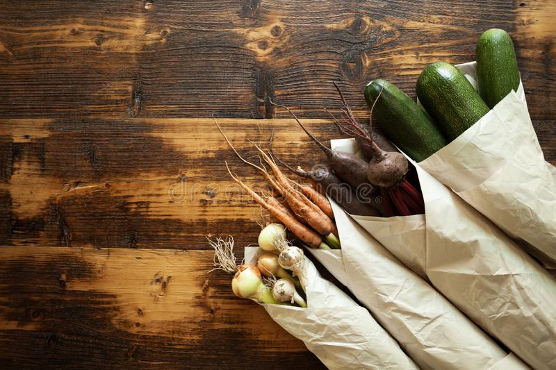 Disposable paper ecological packaging for vegetables. Fresh organic products and waste free lifestyle.  royalty free stock images