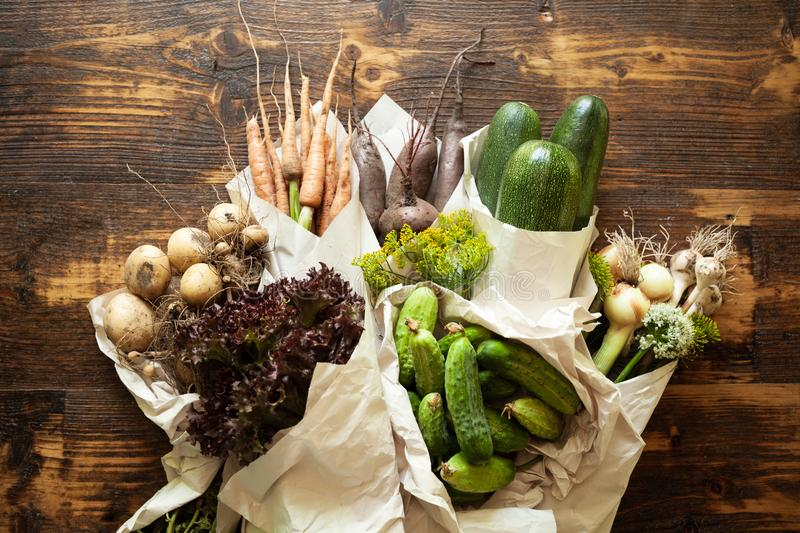 Disposable paper ecological packaging for vegetables. Fresh organic products and waste free lifestyle.  royalty free stock photo