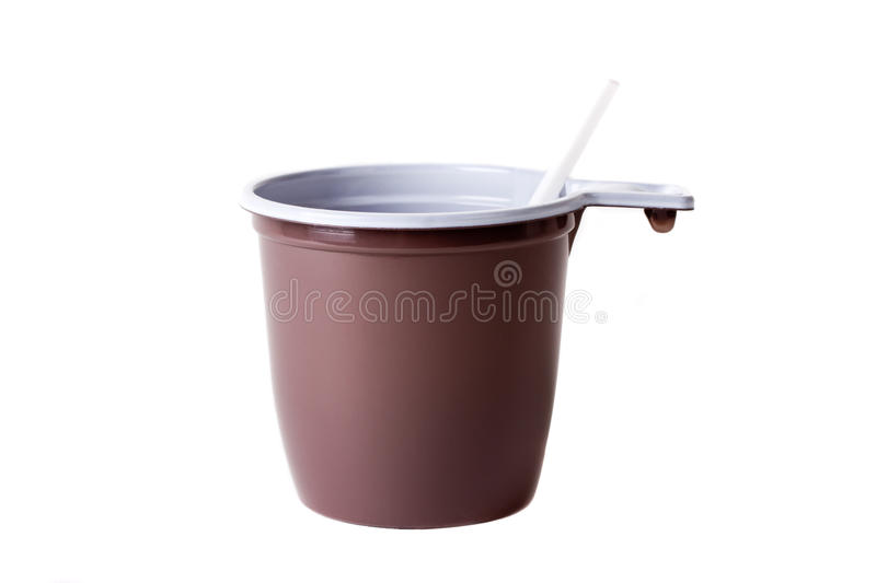 Disposable plastic coffee cup and spoon stock images