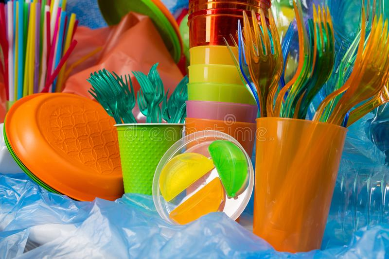 Disposable plastic cutlery of different sizes and textures. Plastic stuff around. Disposable plastic cutlery of different sizes and textures collected together stock photography
