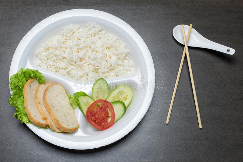 Disposable plastic food plate on black table stock photos