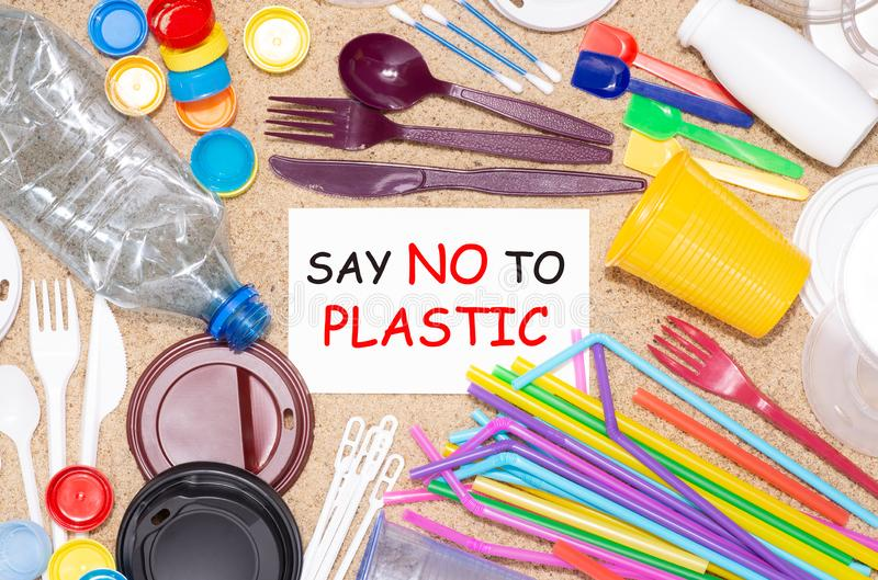 Disposable single use plastic objects  that cause pollution of the environment royalty free stock photo