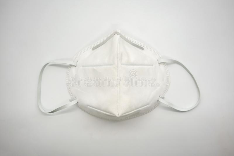 Disposal 3D air pollution or dust mask with adjustable metal noseclip on white back ground. And comfort strap royalty free stock image