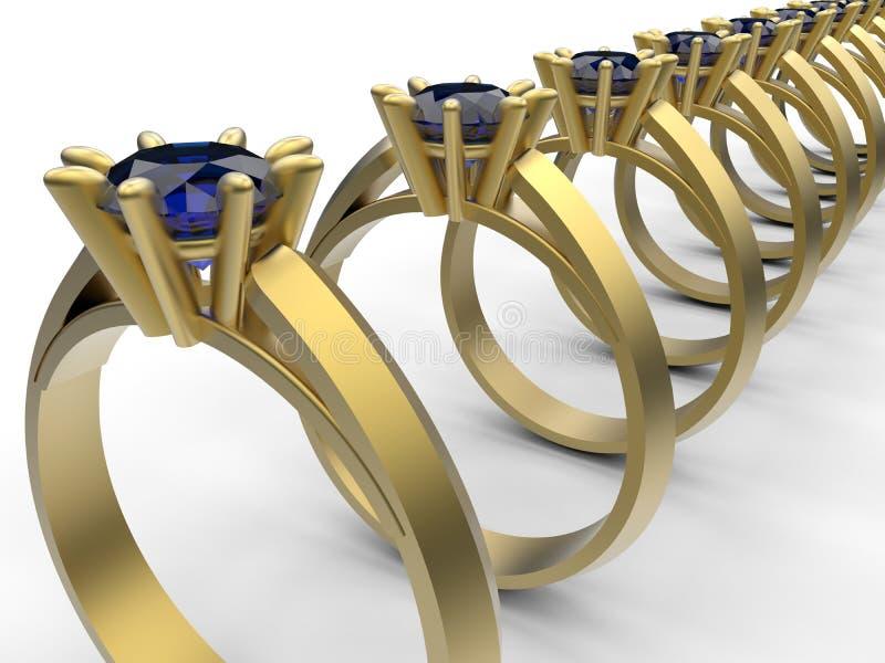Disposição dourada dos anéis com topázio azul imagens de stock royalty free