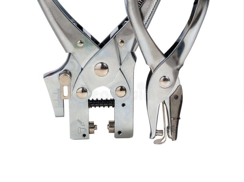 Dispositif de la perforation deux sur un fond blanc, macro image stock