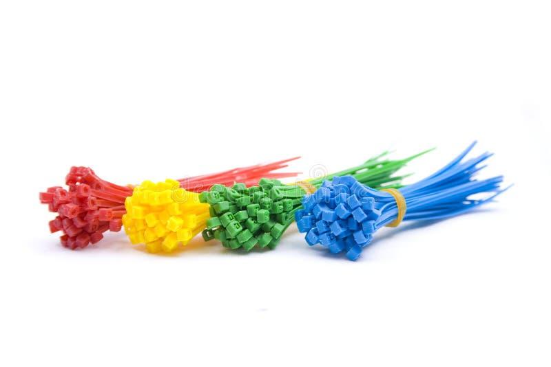 Dispositifs de fixation colorés de relation étroite de fermeture éclair images stock