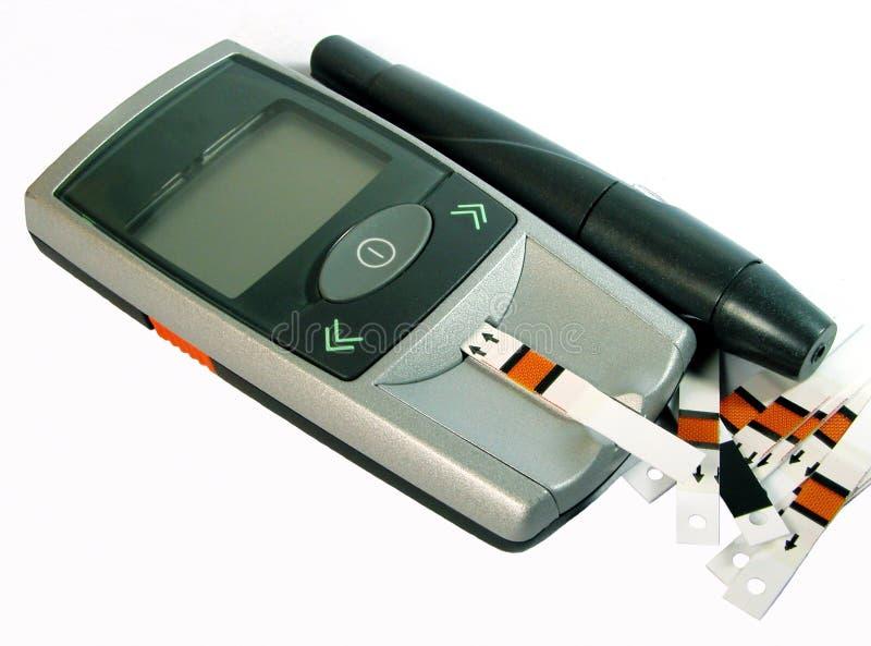 Dispositivo de la supervisión de la glucosa de sangre fotos de archivo