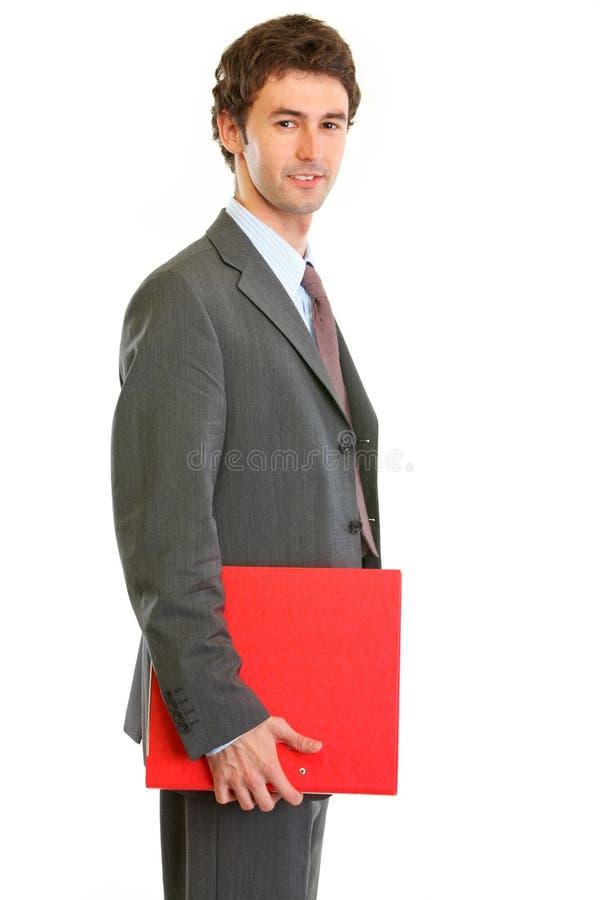 Dispositivo di piegatura moderno della holding degli impiegati immagini stock libere da diritti