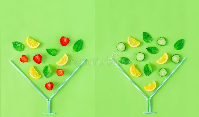 Disposizione creativa Ingredienti della limonata del cetriolo e della fragola, limone, menta che cade in vetro del coctail fatto  fotografie stock