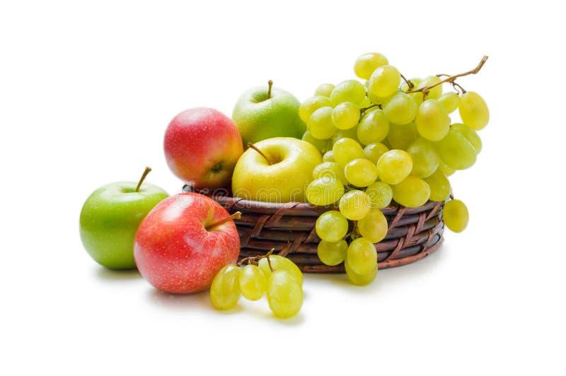 Disposizione dell'uva e delle mele immagine stock