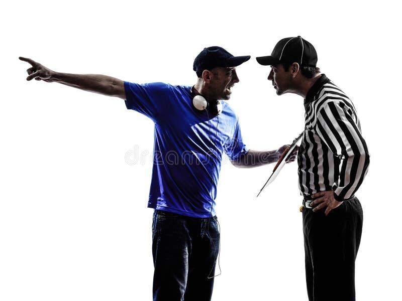 Disputa do conflito do árbitro e do treinador do futebol americano fotografia de stock royalty free