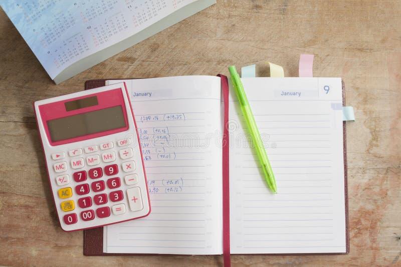 disque mensuel de planificateur de carnet pour financier photos libres de droits