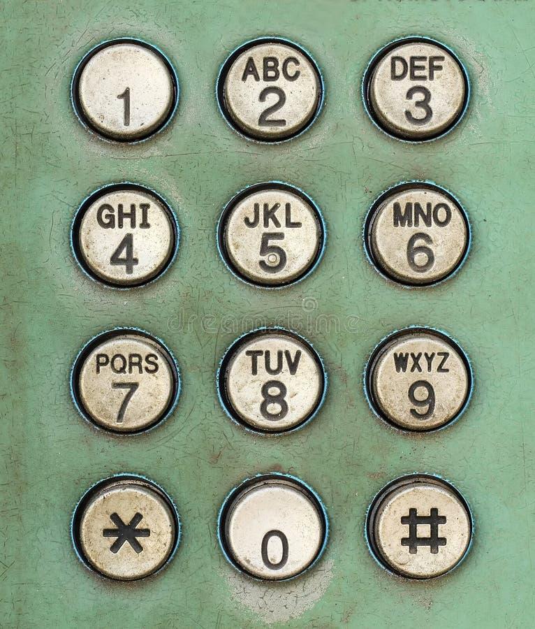 Disque o botão do número no telefone público usado velho imagens de stock royalty free