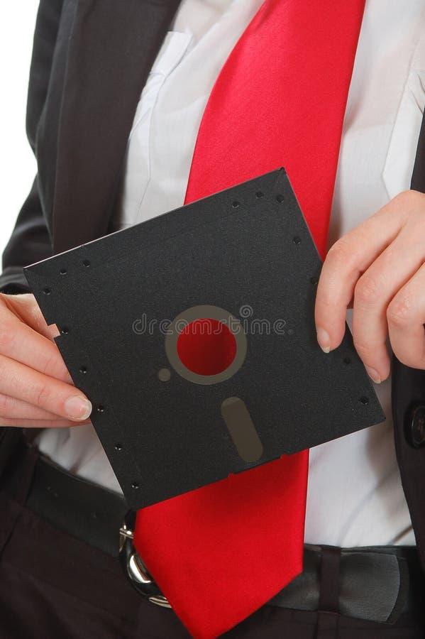 Disque souple rouge de fixation de relation étroite de femme d'affaires photos stock
