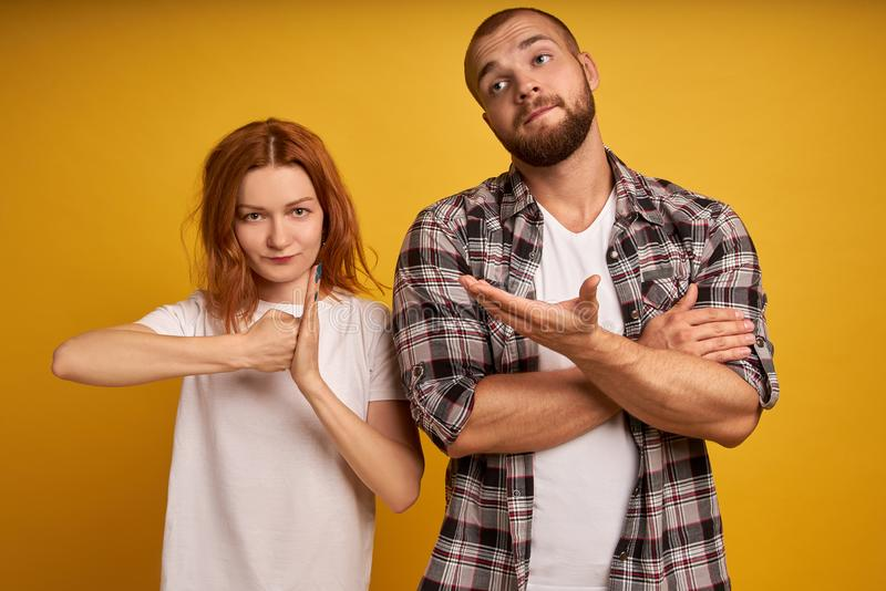 Dissatisfied angry woman clenches fist, confused bearded man gestures with hesitation, express different emotions and feelings, royalty free stock photo