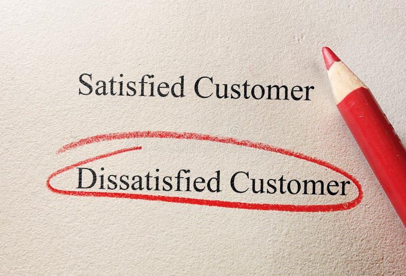 Dissatisfied customer. Red pencil circle around Dissatisfied Customer - customer questionnaire royalty free stock image