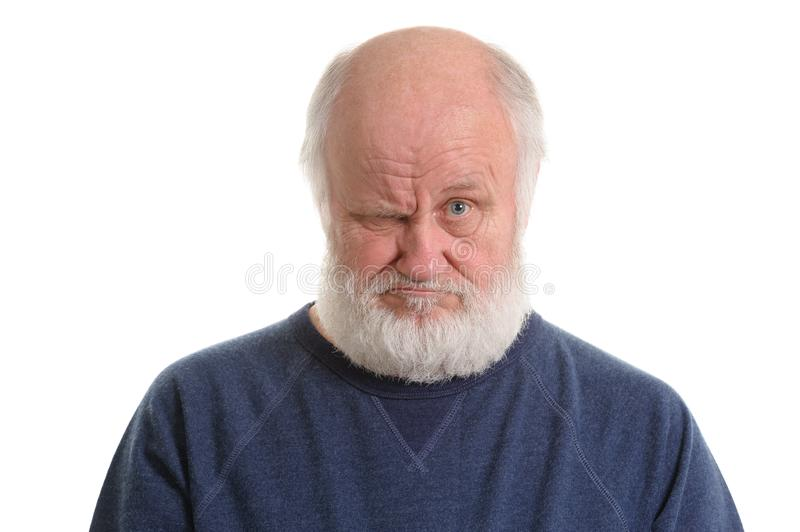 Dissatisfied displeased old grumpy man isolated portrait stock images