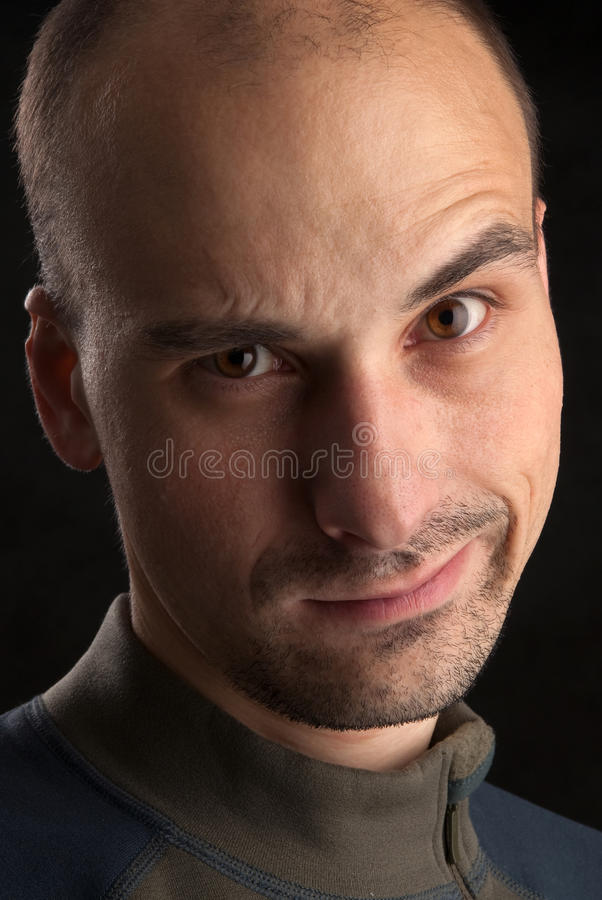 Dissatisfied young man. Portrait of dissatisfied young man stock photography