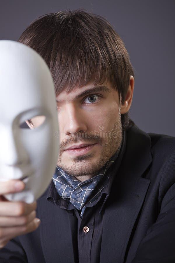 Dissimulation sous le masque photographie stock
