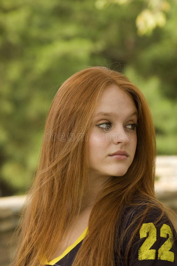 In the distance. Beautiful teen looking over her left shoulder off into the distance royalty free stock photo