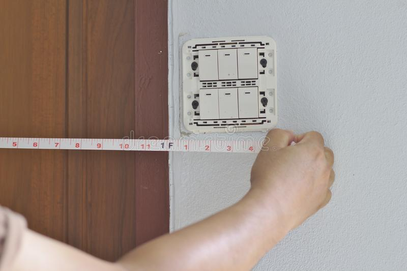 Distance measurement Wall switch panel stock photography