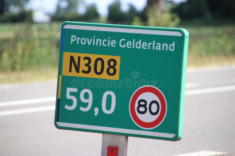 Distance sign along regional road N308 in the Netherlands stock photography