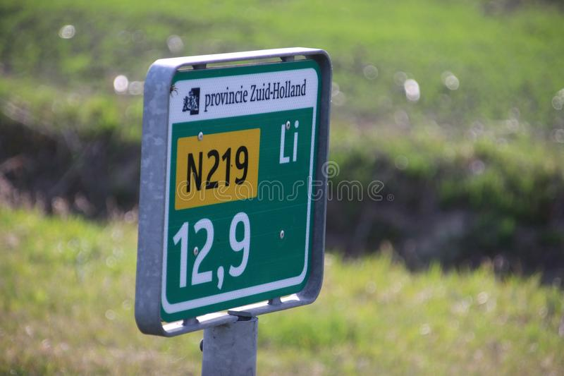 Distance sign along regional road N219 in the Netherlands stock photo