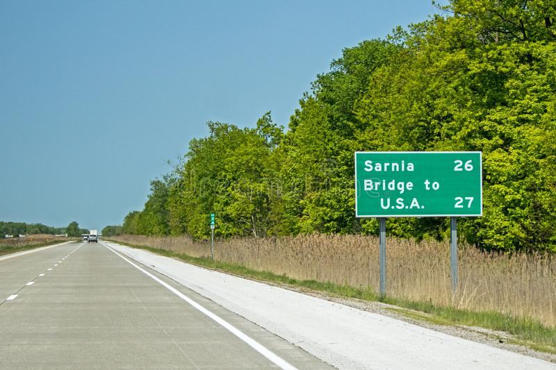 Distance Sign On Highway 402. In Ontario, Canada indicating Sarnia and the Bridge to the United States Blue Water Bridge stock image