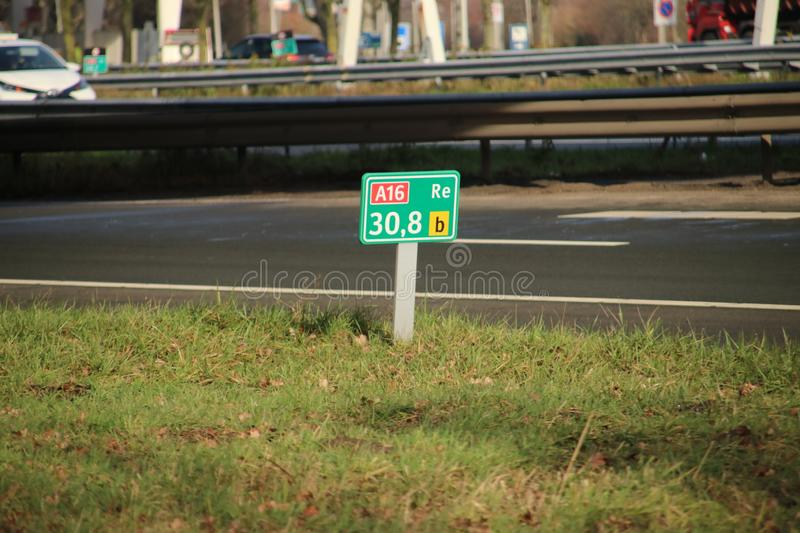 Distance sign at Motorway A16 at Zwijndrecht in the Netherlands. royalty free stock photography