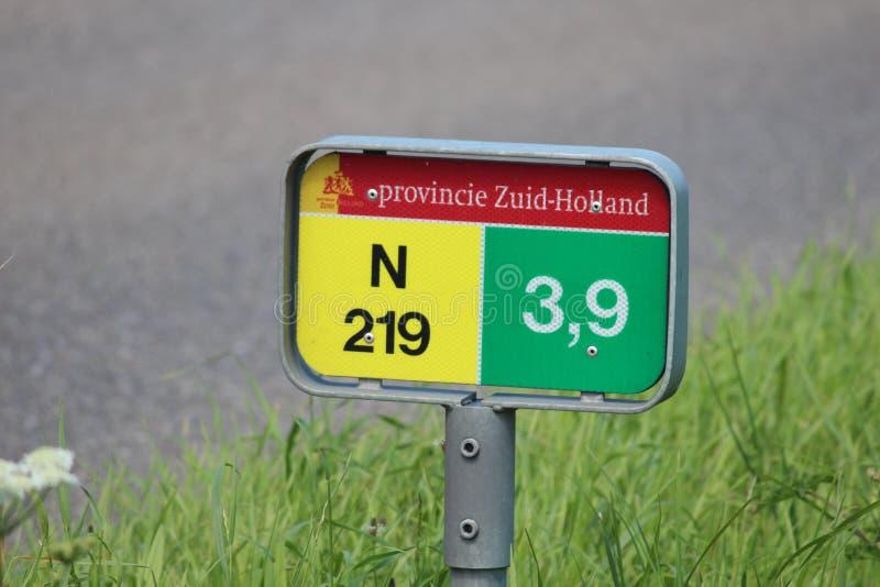 Distance sign on regional road N219 at 3.9 kilometers at Nieuwerkerk aan den IJssel. stock images