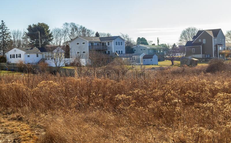Distance view of a small residential neighborhood near Newport, Rhode Island. On a warm winter afternoon royalty free stock photo