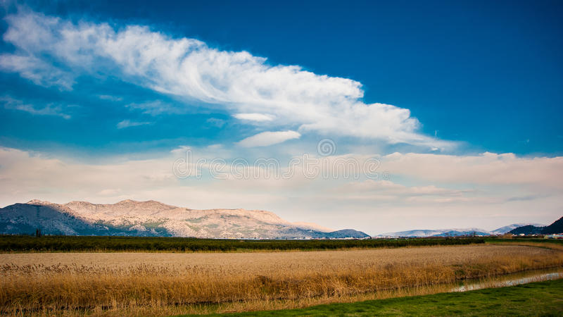 Distant hills with valley in front stock photos