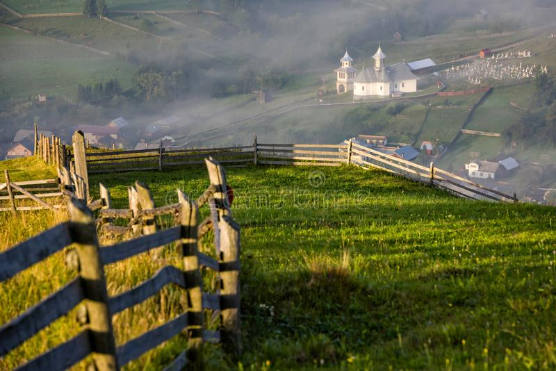 Sunrise over the green and misty villages of Romania royalty free stock images