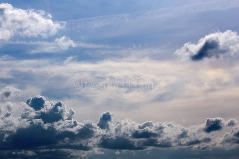 Distant mixed cumulus and feather clouds near horizon closeup telephoto shot with polarizing effect. royalty free stock photos