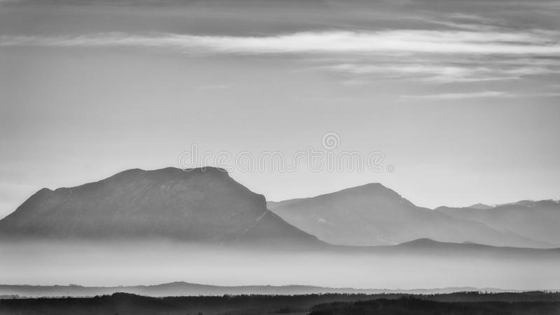 Distant mountain and foggy valleys stock images