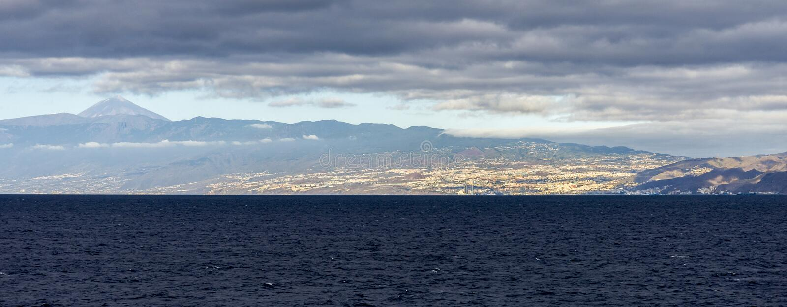 Distant panoramic view of Santa Cruz de Tenerife city with Mount Teide summit in the background, Canary Islands, Spain stock photos