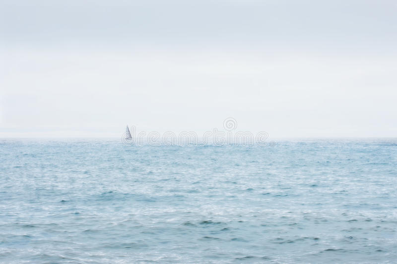 Distant Sailboat, Lake Michigan royalty free stock photos