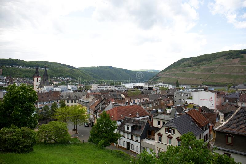Distant view on the buildings in front of the hills under a blue sky in bingen am rhein in hessen germany stock image