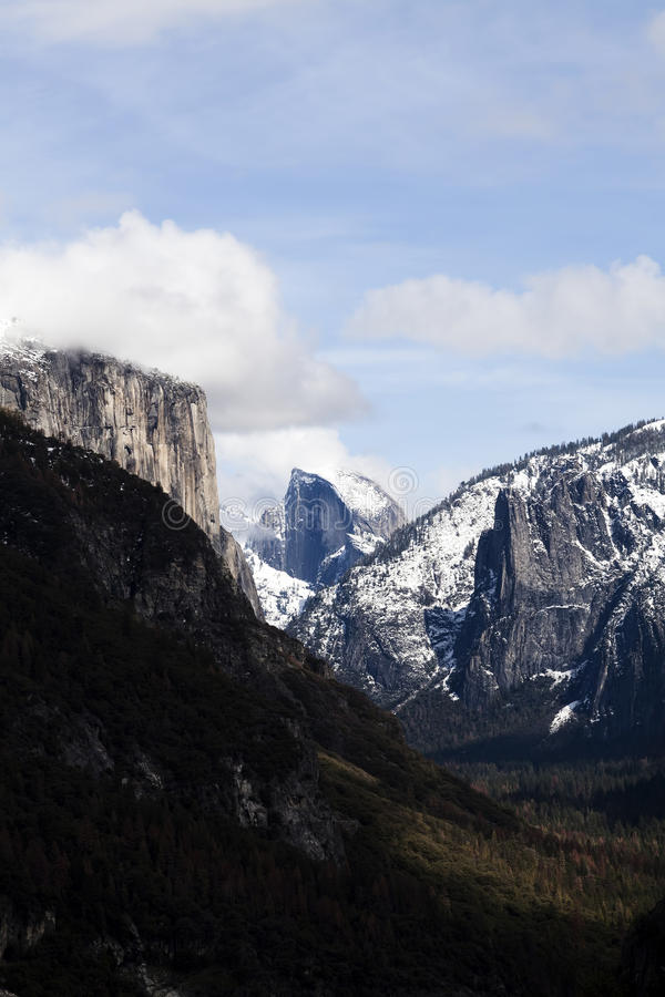 Distant View Halfdome Up Valley Blue Sky. Halfdome And Valley Blue Sky White Clouds Snow Yosemite California royalty free stock photo